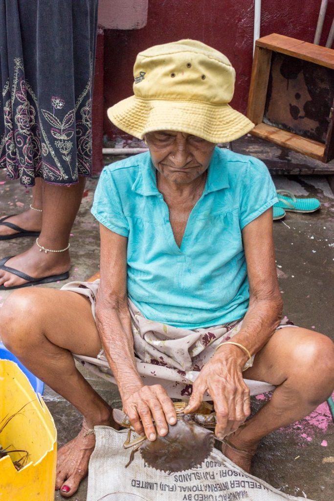grandma cleaning crabs fiji