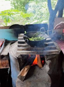 cooking bhindi okra on open fire