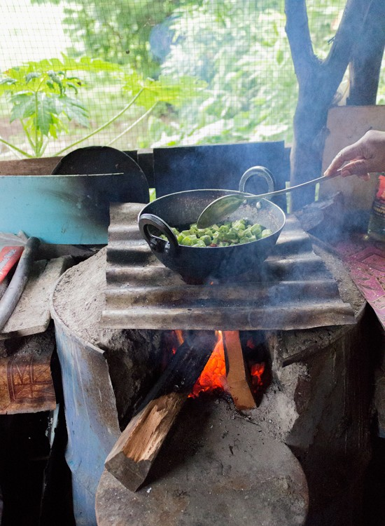 cooking bhindi okra on open fire